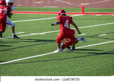 Football player kicking a field goal