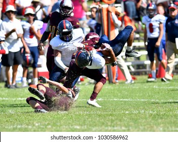 Football player making a great tackle on defense
