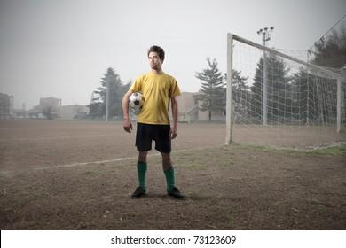 Football player on a football court