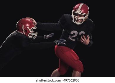 Football player on dark background