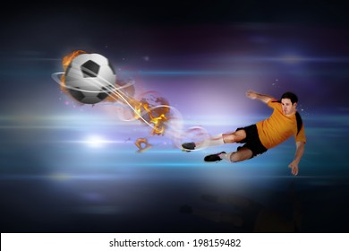 Football player in orange kicking against black background with spark