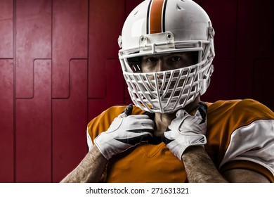 Football Player with a orange uniform on a Locker roon.