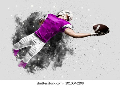 Football Player with a pink uniform coming out of a blast of smoke, catching a ball.
