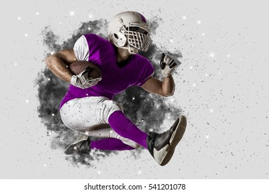 Football Player with a Pink uniform coming out of a blast of smoke .