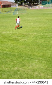 Football player practicing soccer in a stadium