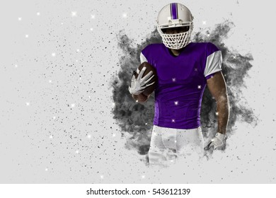 Football Player with a Purple uniform coming out of a blast of smoke .