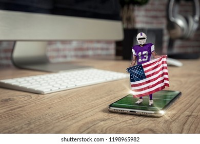 Football Player with a purple uniform playing and coming out of a full screen phone on a wooden table. Watching a football game on demand concept. copy space.