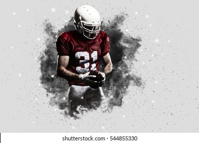 Football Player with a Red uniform coming out of a blast of smoke .