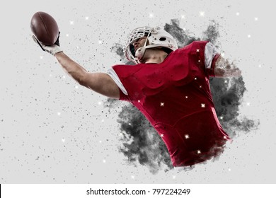 Football Player with a Red uniform coming out of a blast of smoke, catching a ball.