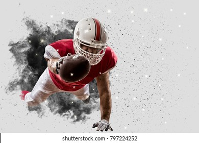 Football Player with a Red uniform coming out of a blast of smoke.
