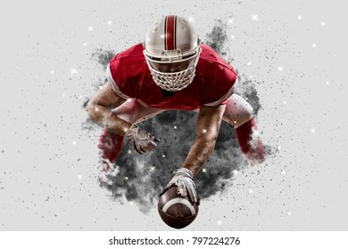 Football Player with a Red uniform coming out of a blast of smoke, on the scrimmage line.