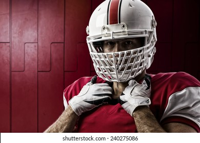Football Player with a red uniform on a Locker room.