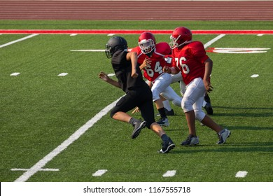 Football Player running to make the tackle