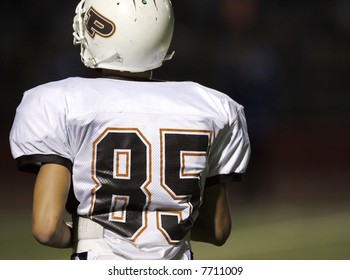 Football player running onto the field