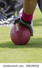 A football player setting up to snap the ball during a game.