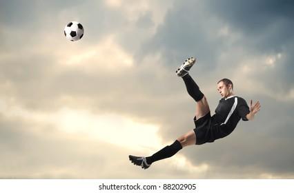 Football player shooting a football