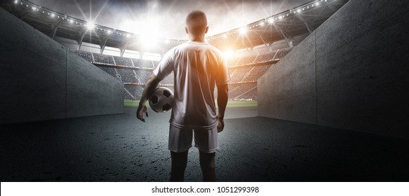 Football player in the stadium