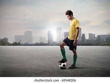 Football player standing on a field with cityscape on the background