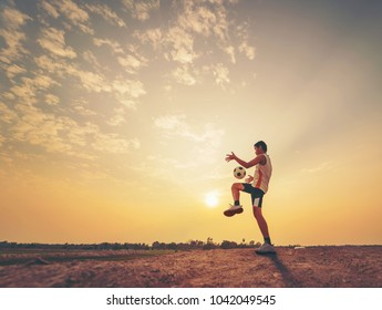 Football player with sunset or sunrise background