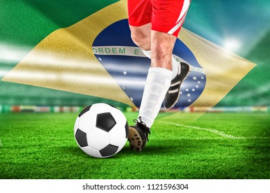 Football player in white kicking against digitally generated brazil national flag