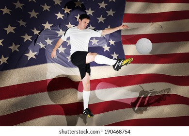 Football player in white kicking against united states of america flag