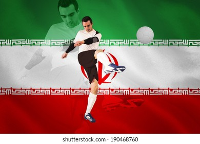 Football player in white kicking against digitally generated iran national flag
