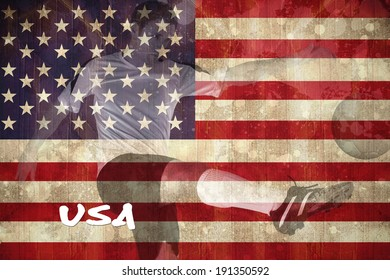 Football player in white kicking against usa flag in grunge effect