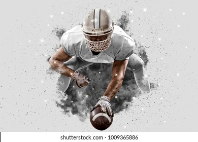 Football Player with a white uniform coming out of a blast of smoke, on the scrimmage line.
