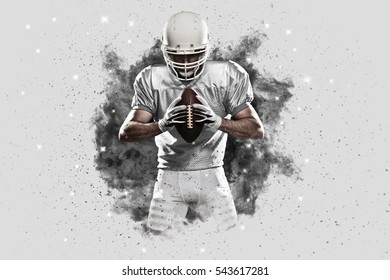 Football Player with a White uniform coming out of a blast of smoke .