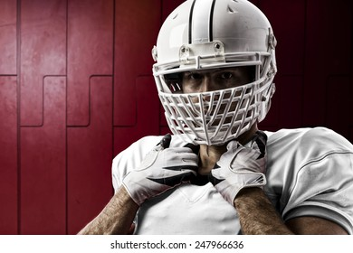 Football Player with a white uniform on a Locker roon.