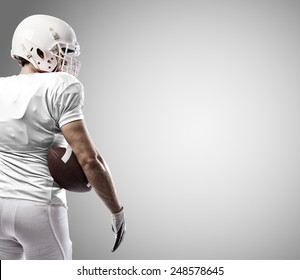 Football Player with a white uniform on a white background.