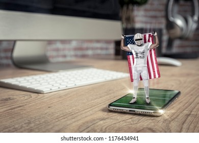 Football Player with a white uniform playing and coming out of a full screen phone on a wooden table. Watching a football game on demand concept. copy space.