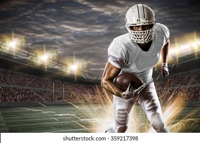 Football Player with a white uniform running on a stadium.