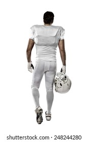 Football Player with a white uniform walking, showing his back on a white background.