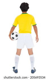 Football player in yellow holding ball on white background