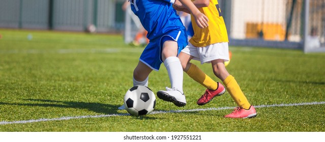 Football Players Compete For a Ball. Children Playing Sports on Grass Pitch. Two Kids in Soccer Duel on Sideline. Closeup Image of Youth Football Competition Match
