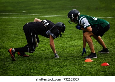 Football players offense defense in action