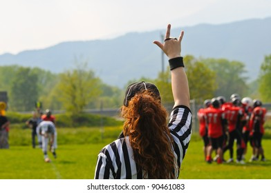 Football Referee with hand up