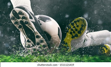 Football scene at night match with close up of a soccer shoe hitting the ball with power