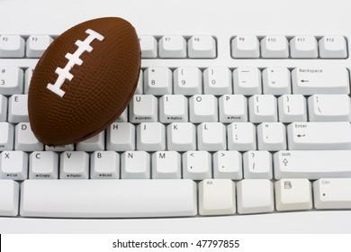 A football sitting on a computer keyboard, Playing fantasy football