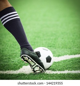 Football or soccer ball at the kickoff of a game