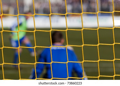 Football soccer goal net with grass background