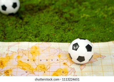 """Football (soccer) and map """"Russia"""" on green moos background. Sport world concept. Copy space. Can be use decorate for advertising icon or brochure."""