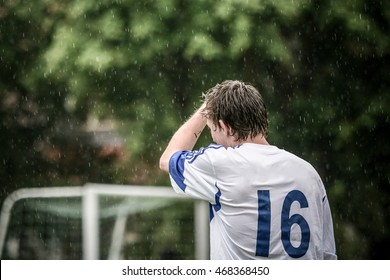 Football (Soccer) player in front of goal in the rain