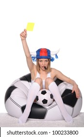 Football and soccer supporter showing yellow card on white background