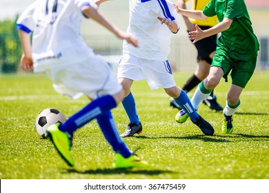 Football soccer tournament for youth teams. Soccer football training camp for kids, children. Young boys playing football soccer match.