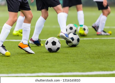 Football Soccer Training Drills: Young Players Practicing Soccer Run with Ball. Soccer Training on Fresh Grass Field