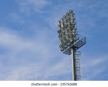 football stadium floodlight in blue sky and white cloud
