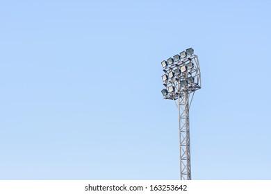 football stadium floodlight in blue sky