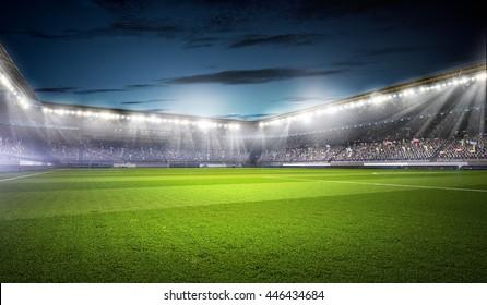 Football stadium in lights . mixed media